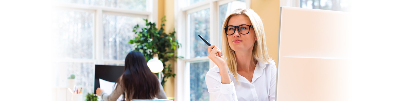 Business woman with glasses holding pen
